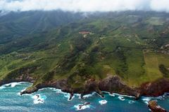 Pacific surf on the east coast of the island of Maui in Hawaii. Aerial view of Maui`s eastern coastline shows everything from Pacific surf to mountains and Royalty Free Stock Photo