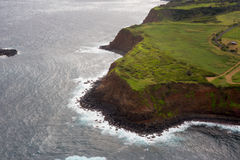 Aerial view of Maui`s North Coast.  Road to Hana. Spectacular view of the ocean washing over Maui`s North Coast. Road to Hana, Maui Hawaii. Aerial view from the Royalty Free Stock Images