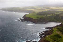 Aerial view of Maui`s North Coast.  Road to Hana. Spectacular view of the ocean washing over Maui`s North Coast. Road to Hana, Maui Hawaii. Aerial view from the Stock Image