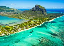 Aerial view of Mauritius island. Panorama and famous Le Morne Brabant mountain, beautiful blue lagoon and underwater waterfall stock images