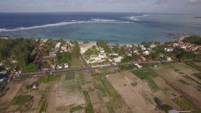 Aerial view of Mauritius Island and Indian Ocean. Flying from mainland with farmlands and woods to the coast with houses and resorts. Scenic view of Mauritius stock footage
