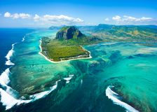 Aerial view of Mauritius island. Panorama and famous Le Morne Brabant mountain, beautiful blue lagoon and underwater waterfall stock photography