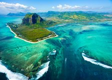 Aerial view of Mauritius island. Panorama and famous  Le Morne Brabant mountain, beautiful blue lagoon and underwater waterfall Royalty Free Stock Photography
