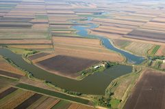 Aerial View -  Meandering river. Royalty Free Stock Images