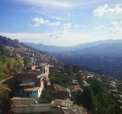Contrasts of poverty and cosmopolitan life in Medellin, Colombia royalty free stock image