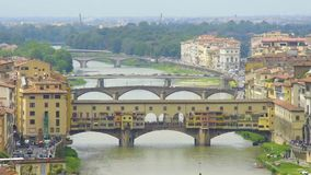 Aerial view of medieval arch bridge Vecchio across the Arno river in Florence. Stock footage stock footage