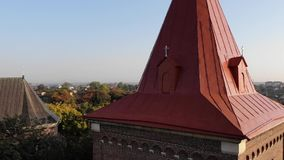 Aerial view of medieval Bell Tower of St.Bartholomew church. Landscape of Drohobych city. Crane shot, stock footage
