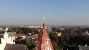 Aerial view of medieval Bell Tower of St. Bartholomew church Landscape of Drohobych city. Smooth pan around dome of bell stock video footage