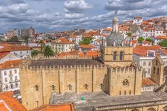 Aerial view of the medieval building of Coimbra Cathedral, Coimbra city and sky as background, Portugal. Coimbra / Portugal - 04 04 2019 : Aerial view of the stock photos