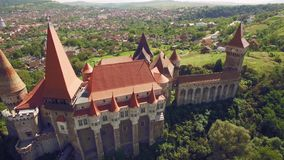 Aerial view of a medieval castle surrounded by green park stock footage