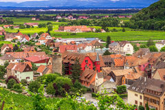 Aerial view of medieval Kaysersberg, France. Aerial view of the city of historic medieval Kaysersberg with dramatic cloudscape, Alsace, France Royalty Free Stock Image