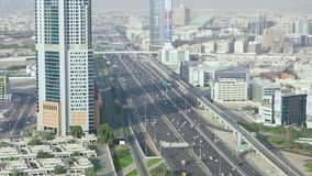 Aerial view of a megapolis with skyscrapers and multi lane road with heavy traffic. Stock. Beautiful landscape of a stock video footage