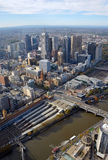 Aerial View of Melbourne City including Yarra River. Aerial View of Melbourne City. In the foreground is the Yarra River & Flinders Street Station and in the Stock Photo