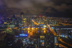 An aerial view of Melbourne cityscape including Yarra River and. Victoria Harbour in the distance during cloudy night Royalty Free Stock Images