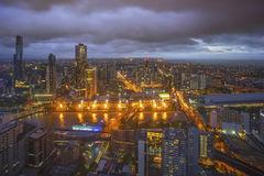 An aerial view of Melbourne cityscape including Yarra River. And Victoria Harbour in the distance during sunset with beautiful sun ray bursting through clouds Royalty Free Stock Photo