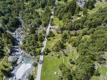 Aerial view of the Mello Valley, Val di Mello, a green valley surrounded by granite mountains and forest trees. Val Masino. Italy Stock Image
