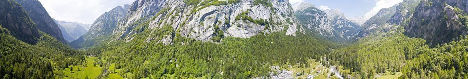 Aerial view of the Mello Valley, Val di Mello, a green valley surrounded by granite mountains and forest trees. Val Masino. Italy Stock Photo