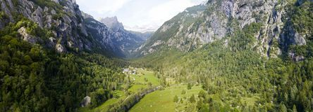 Aerial view of the Mello Valley, a valley surrounded by granite mountains and forest trees, renamed the little italian Yosemite Stock Image
