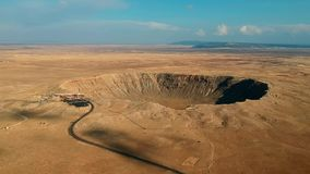 AERIAL VIEW OF METEOR CRATER / BARRINGER CRATER IN ARIZONA, NEAR WINSLOW AND FLAGSTAFF. DRONE SHOT.