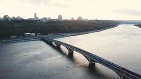 Aerial view of the metro bridge in Kiev, Ukraine. Lively traffic. Aerial view of the metro bridge in Kiev, Ukraine. Busy the traffic stock video