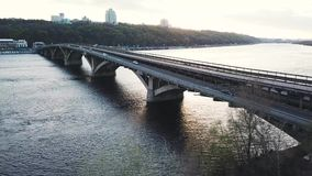 Aerial view of the metro bridge in Kiev, Ukraine. Lively traffic. Shooted at different speeds - normal and fast. Aerial view of the metro bridge in Kiev, Ukraine stock footage