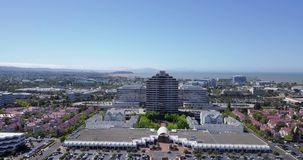 Aerial view of metro center tower in foster city. Near Visa Global HQ on hills dale blvd with horizon stock footage