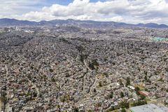 Aerial view of mexico city. Houses covering hills in one of the most populated living areas close to mexico city called los cuartos Royalty Free Stock Photos