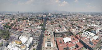 Aerial view of Mexico City in urban zone. Aerial view mexico city urban zone mexican travel tourism vacation landscape pollution fog cloudy history historic royalty free stock image