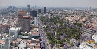 Aerial view of Mexico City in urban zone. Aerial view mexico city urban zone mexican travel tourism vacation landscape pollution fog cloudy history historic royalty free stock photos