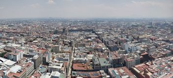 Aerial view of Mexico City in urban zone. Aerial view mexico city urban zone mexican travel tourism vacation landscape pollution fog cloudy history historic royalty free stock images