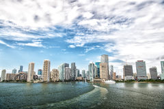 Aerial view of Miami skyscrapers with blue cloudy sky, boat sail Stock Photos