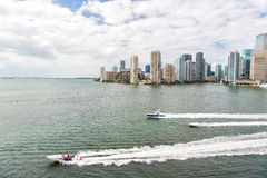 Aerial view of Miami skyscrapers with blue cloudy sky, boat sail Stock Photography