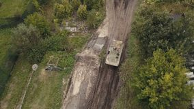 Aerial view military soldiers sittingon moving army tank on shooting training. Military vehicle driving on battle field stock video