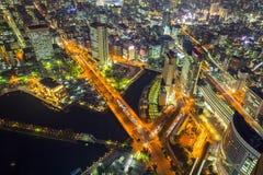 Aerial view of of Minato Mirai 21 district in Yokohama at night. Yokohama, Japan - November 8, 2016 : Aerial view of of Minato Mirai 21 district in Yokohama at Stock Photos