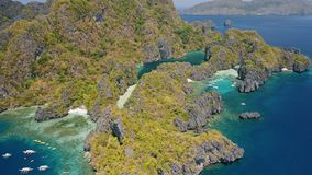 Aerial view of Miniloc Island. El-Nido, Palawan. Philippines. Limestone karst rock ridge formation and beautiful blue. Tropical lagoons stock footage