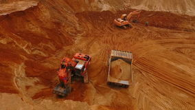 Aerial view of mining machinery working at sand quarry. Mining equipment stock video footage