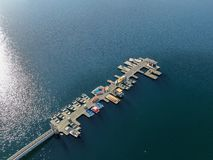 Aerial view of Miramar Lake small pier with pedal boat, small motor boat. royalty free stock photo