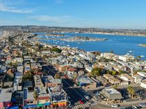 Aerial view of Mission Bay & Beaches in San Diego, California. USA. Community built on a sandbar with villas, sea port.  & recreational Mission Bay Park royalty free stock photos