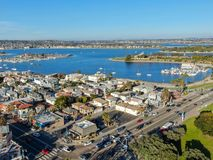 Aerial view of Mission Bay & Beaches in San Diego, California. USA. Community built on a sandbar with villas, sea port.  & recreational Mission Bay Park royalty free stock photo