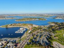 Aerial view of Mission Bay & Beaches in San Diego, California. USA. Community built on a sandbar with villas, sea port.  & recreational Mission Bay Park royalty free stock image