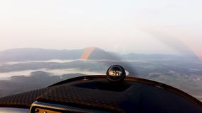Aerial view of misty landscape from the cockpit of small propeller airplane. Freedom above the clouds stock footage