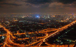 Aerial view of modern big city at night. (warm colors Stock Photos