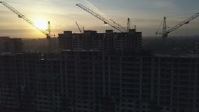 Aerial view of modern city construction and development. At sunset stock footage