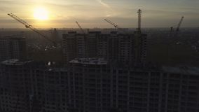 Aerial view of modern city construction and development. At sunset stock video footage