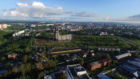 Aerial view of a modern city at sunset. Clip. Top view of the city in summer at sunset royalty free stock photo