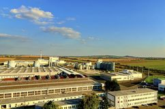 Aerial view of modern factory. Modern plant with blue sky. Royalty Free Stock Photo