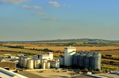 Aerial view of modern factory. Modern plant with blue sky. Steel storage tanks. Stock Photography