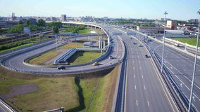 Aerial view of modern highway interchange near city on a sunny summer day stock video
