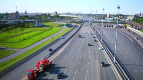 Aerial view of modern highway interchange near city on a sunny summer day stock video footage