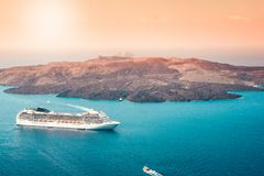 Aerial view of modern luxury tourist cruise ship in the bay of Santorini, Greece.  stock photo
